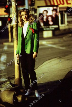 Stock Picture of Model Elaine Irwin at city street corner. She is wearing an ensemble from Ronaldus Shamask: a apple-green linen blazer, red handkerchief, white linen shirt, black cotton cardigan and black linen/silk pants. Styled with shoes from Guess Footwear by Georges Marciano. Hair by Christiaan. Makeup by Sonia Kashuk. Elaine Irwin