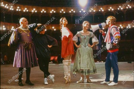 """Dancer Mikhail Baryshnikov with actors Leslie Browne, Julie Kent, and Alessandra Ferri, with an unidentified actor on the stage of the Teatro Petruzzelli in Bari, Italy, during the production of director Herbert Ross' 1987 movie """"The Dancers"""". Mikhail Baryshnikov, Julie Kent, Leslie Brown, Alessandra Ferri"""