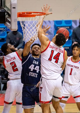 Utah State guard Marco Anthony (44) works to get a shot away as he's defended by Texas Tech guard Jamarius Burton (2) and forward Marcus Santos-Silva (14) during the first half of a first round game in the NCAA men's college basketball tournament, at Assembly Hall in Bloomington, Ind