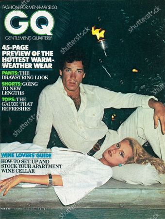 Stock Image of GQ May 01, 1976 Magazine Cover featuring: White with blue and green logo with photo of two models poolside, he wears a white gauze shirt and pants by Bill Kaiserman for Rafael accesorized by an Aldo Cipullo gold chain, and a Christain Dior leather belt, her dress is by Ronald Kolodzie for Concept VII.