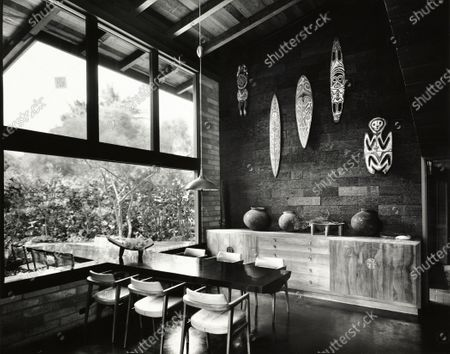 Ideas to Emulate: an indoor-outdoor table cantilevered from the window sill, highly polished on top, merely stripped of bark on the bottom, at Jean Charlot's house in Hawaii.