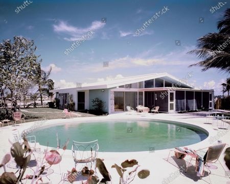 General Electric Wonder House in Miami, Florida, overlooking Biscayne Bay, designed by architect Robert M. Little, decorated by H & G with Waldo Frank Perez of Burdine's: rear of house overlooking pool and Biscayne Bay.