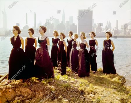 Glamour's 10 Best-Dressed college Girls, standing in front of New York skyline wearing dresses by Anne Forgarty, M'lle Ricci, Rappi, Eloise Curtis, Cotillion, Roban. Conny Perrin