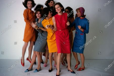 Group of models in the fad of the summer : T-shirt dress by Abby Michael (see issue for details about shoes and cap worn by the models). Carina Round