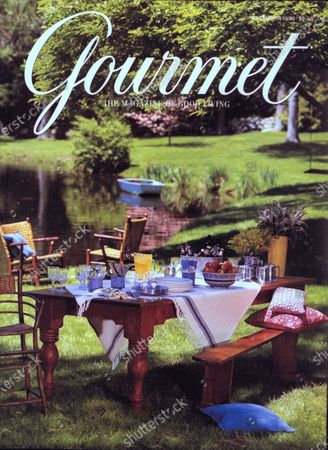 Gourmet September 01, 1998 Magazine Cover featuring: Table set for family reunion on lawn near pond.