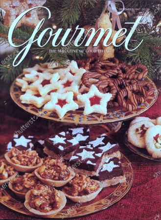 Gourmet December 01, 1997 Magazine Cover featuring: An array of holiday sweets at a festive cookie exchange.