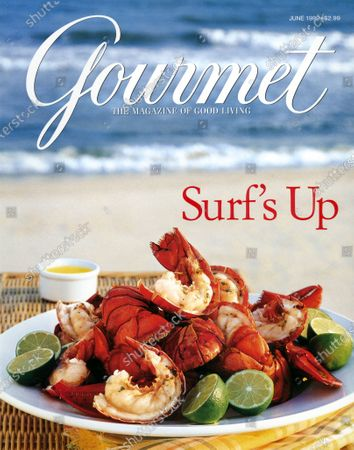 Gourmet June 01, 1999 Magazine Cover featuring: Grilled lobster with lime halves at the seashore.