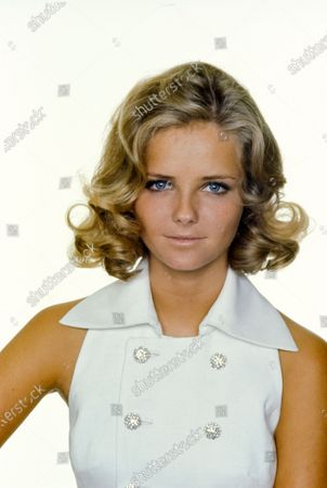 Headshot of Cheryl Tiegs in a white linen halter dress with rhinestone buttons, by Frank Adams for Junior Accent, with makeup by Helena Rubinstein. Chantal Janzen
