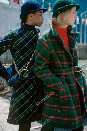 Model on left wearing a blue and green plaid wool suit by Louis Clausen for P.R.L. Model on right wearing a green and red plaid belted coat by Don Simonelli for Modelia.
