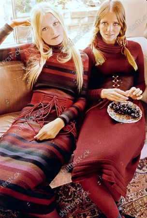 Model on left touching head, wearing ankle-length, striped sweaterdress by Pinky and Dianne. Model on right wearing a midilength pullover sweaterling with a deep cowl neck by Daniel Hechter. All belts by Elegant and hair by Maury Hopson. Gunilla Lindblad, Cheryl Tiegs