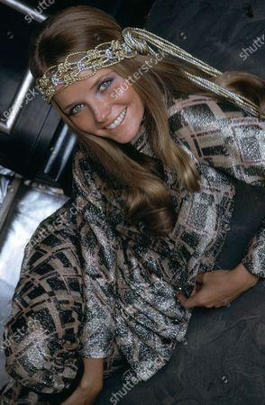 Cheryl Tiegs wearing silver and gold belt as a headband by Myra Harding, Lurex smoking suit by Victor Joris. Cheryl Tiegs