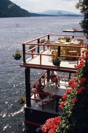 The Adirondack house of Ben Wyker and Judith Garden Wyker: looking onto double-level deck that extends over the water.