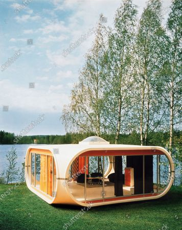 Prototype of Polykem molded house, with fiberglass exterior, overlooking the Kemijoki River in Finland; designed by architect Matti Suuronen and manufactured by the Polykem company.