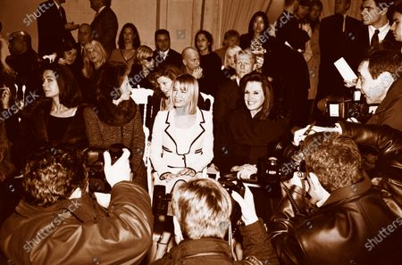 Actress Renee Zellweger at the Balmain fashion show in Paris, wearing a suit from Chanel Haute Couture, and sitting in the front row between couture customers Deeda Blair and Patricia Altschul. Renee Zellweger