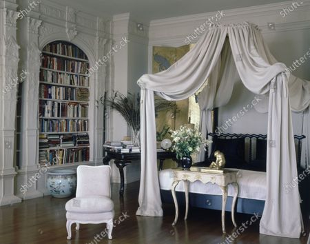 Master bedroom with carved pilasters by Leo Lentelli and a Majorcan bed hung with drapery, in the home of John and Dodie Rosekranz, originally built in 1917 by architect Willis Jefferson Polk and with modern interior design by Michael Taylor.