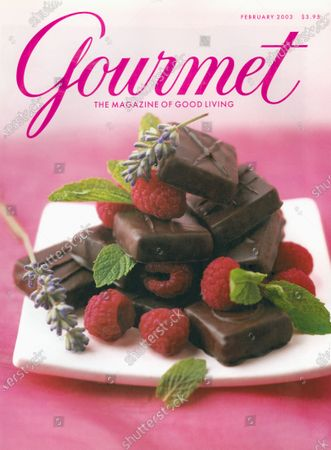 Stock Image of Gourmet February 01, 2003 Magazine Cover featuring: Philadelphia's Jubilee Chocolate, cofounders by John Doyle and Kira Baker, displays an assortment of chocolate and raspberries.