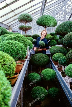 Mrs. Paul Mellon in her greenhouse in Upperville, Virginia. Bunny Mellon