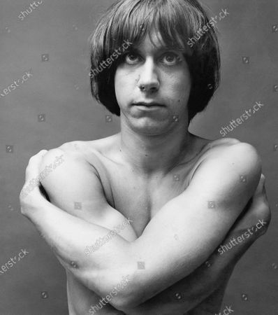 Portrait of musician Iggy Stooge (aka Iggy Pop) bare-chested with arms crossed. Iggy Pop