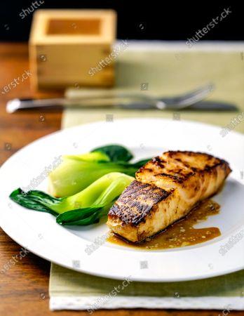 Sake Kasu-marinated black cod with baby bok choy; recipe from Salish Lodge & Spa in Washington; Styled by Ruth Cousineau.