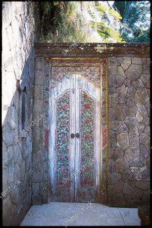 Handcarved vintage door at Bali's Begawan Giri Estate.