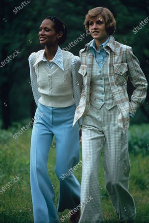 On the left, model Beverly Johnson is wearing a silvery sweater vest, a blue polka dot shirt and pale blue pants, all by Wippette. The model on the right is wearing a pastel brown plaid jacket, matching blue tattersall vest and pants, and blue crepe shirt, all by Ellen Tracy. Beverly Johnson