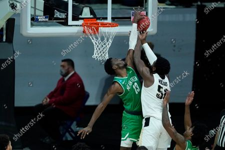 Stock Image of Purdue's Trevion Williams (50) has his shot blocked by North Texas's Thomas Bell (13) during the second half of a first-round game in the NCAA men's college basketball tournament at Lucas Oil Stadium, in Indianapolis