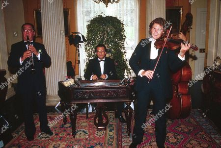 CLASSICAL ORCHESTRA AT WEDDING OF BARON HEINI VON THYSSEN AT MORETON IN MARSH GLOUCESTERSHIRE BRITAIN 1985