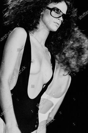 Model walks the Yves Saint Laurent runway show.