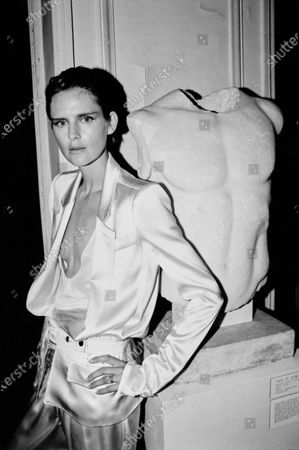 """Model Stella Tennant wears a YSL satin suit while standing next to """"Torse de Juene.."""" reproduction. Stella Tennant"""