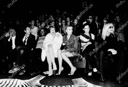 At the YSL show in the front row sits Isabella Blow, with unknown women, Stella Tennant and Betty Catroux. Isabella Blow, Stella Tennant, Betty Catroux