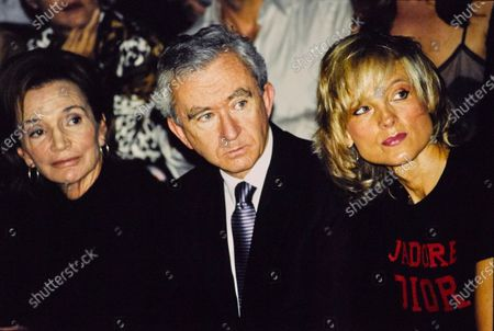 Lee Radziwill sits with Bernard and Helene Arnault at the Louis Vuitton show. Lee Radziwill, Bernard Arnault, Helene Arnault