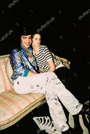 Model Stella Tennant sits with designer John Galliano. Stella Tennant, John Galliano