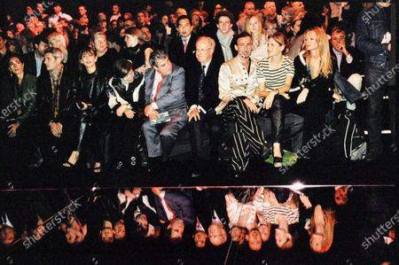 Model Stella Tennant sits front row at the John Galliano show with John Bult, Alexis Roche & Delphine Arnault. Stella Tennant, John Bult, Delphine Arnault, Alexis Roche