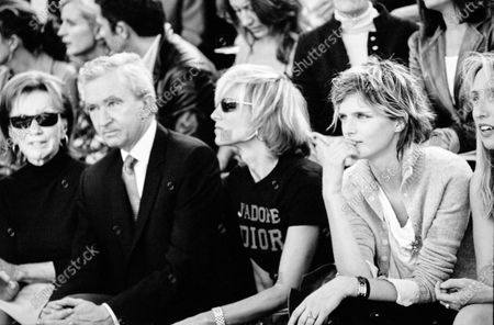 Stella Tennant sits at the Louis Vuitton show with, Lee Radziwill, and LVMH's executive Bernard Arnault and his wife, Helene Arnault. Stella Tennant, Lee Radziwill, Bernard Arnault, Helene Arnault