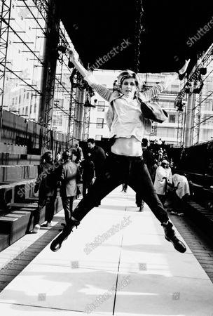 Model Stella Tennant jumps in the air at the Marc Jacobs Louis Vuitton Paris show. Stella Tennant