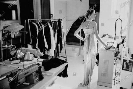 Model Stella Tennant stands wearing a Rick Owens gown in their workroom. Stella Tennant