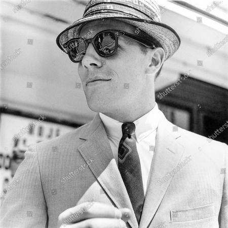 Head and shoulder shot of model, wearing a herringbone weave Dacron & cotton Cricketeer suit.