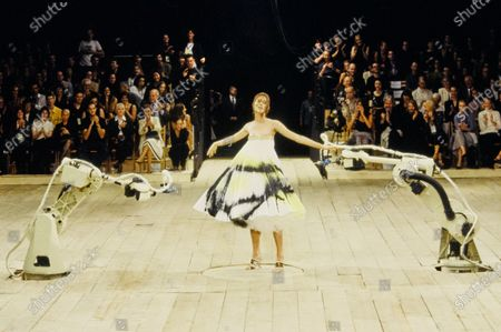 Shalom Harlow sprayed with paint by robots during the finale of the Alexander McQueen Spring 1999 RTW show, ca. September 1998. Shalom Harlow