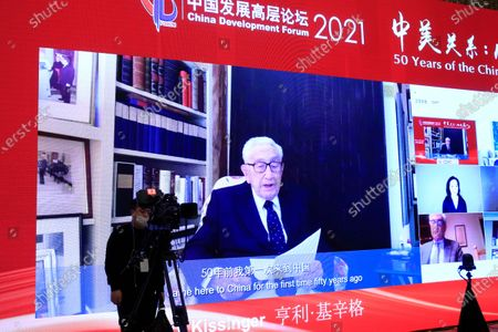 Stock Image of A video shows Henry Kissinger, Chairman, Kissinger Associates Inc. and Former Secretary of State, speaking during the China Development Forum 2021 at the Diaoyutai State Guesthouse in Beijing, China, 20 March 2021. The China Development Forum 2021 is held in Beijing from 20 to 22 March 2021, with the theme of 'China On a New Journey of Modernisation.'