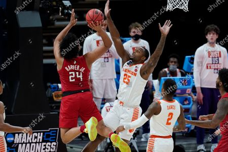 Rutgers guard Ron Harper Jr. (24) drives on Clemson forward Aamir Simms (25) during the first half of a men's college basketball game in the first round of the NCAA tournament at Bankers Life Fieldhouse in Indianapolis