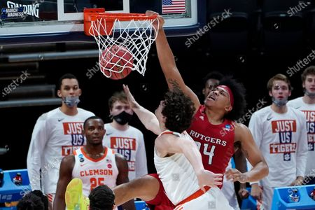 Rutgers guard Ron Harper Jr. (24) dunks on Clemson forward PJ Hall (24) during the first half of a men's college basketball game in the first round of the NCAA tournament at Bankers Life Fieldhouse in Indianapolis