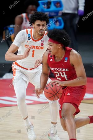 Rutgers guard Ron Harper Jr. (24) drives on Clemson forward Jonathan Baehre (1) during the first half of a men's college basketball game in the first round of the NCAA tournament at Bankers Life Fieldhouse in Indianapolis