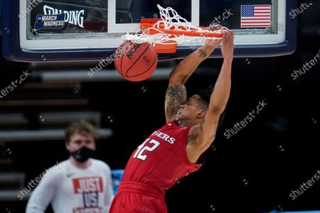 Rutgers guard Jacob Young (42) dunks against Clemson during the first half of a men's college basketball game in the first round of the NCAA tournament at Bankers Life Fieldhouse in Indianapolis