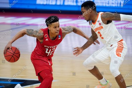Rutgers guard Jacob Young (42) drives on Clemson guard Al-Amir Dawes (2) during the second half of a men's college basketball game in the first round of the NCAA tournament at Bankers Life Fieldhouse in Indianapolis