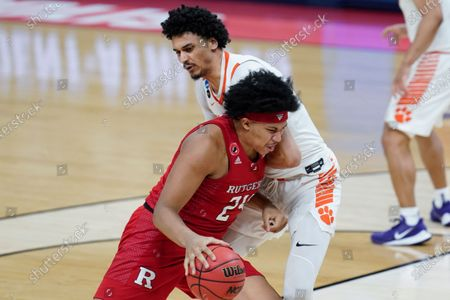 Rutgers guard Ron Harper Jr. (24) drives on Clemson guard Chase Hunter (3) during the second half of a men's college basketball game in the first round of the NCAA tournament at Bankers Life Fieldhouse in Indianapolis