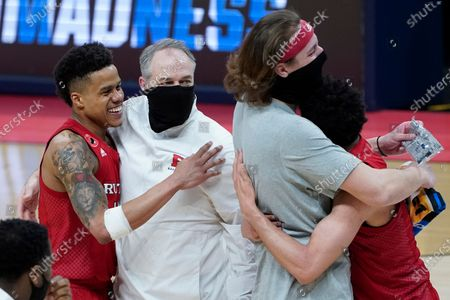 Rutgers guard Jacob Young, left, and head coach Steve Pikiell celebrate after beating Clemson 60-56 in a men's college basketball game in the first round of the NCAA tournament at Bankers Life Fieldhouse in Indianapolis, . Rutgers won 60-56