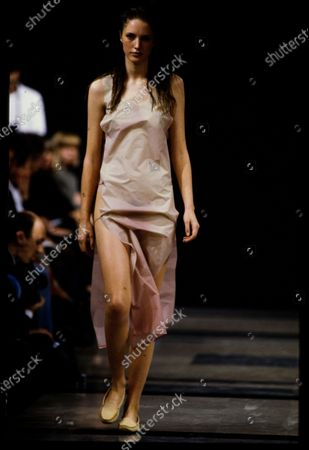 Model walks Helmut Lang's Spring 1991 RTW (pret a porter) Runway collection. Cecilia Chancellor