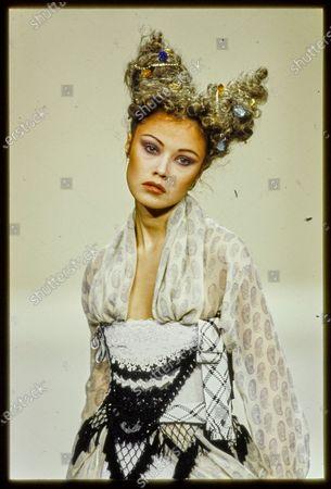 Model Tatiana Sorokko walks Vivienne Westwood's Fall 1994 RTW Runway collection. Tatiana Sorokko