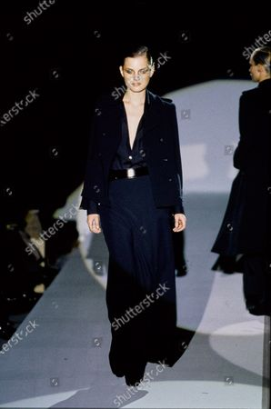 Model walks Gucci's RTW (pret a porter) Fall 1996 Runway collection designed by Tom Ford. Guinevere Van Seenus