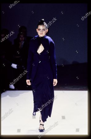 Model walks Comme des Garcons' RTW (pret a porter) Spring 1997 Runway collection, (Bumps Collection) designed by Rei Kawakubo. Guinevere Van Seenus